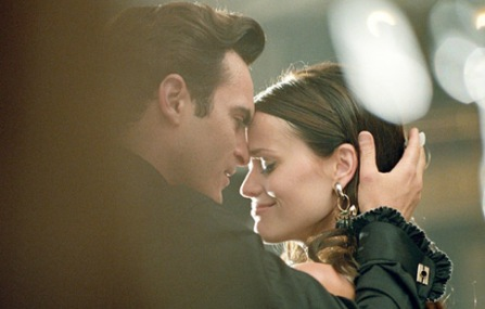 Joaquin Phoenix & Reese Witherspoon as Johnny & June Carter Cash