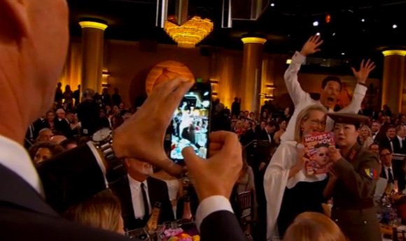 Keaton taking a photo of Meryl w/ Margaret Cho dressed as Kim Jong Cho