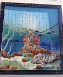 A sponge diving mural