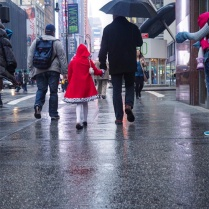 [hubby's shot] Lil girl in red in rainy Times Square
