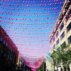 A stretch of Rue Saint Catherine w/ the pink balls *roof*