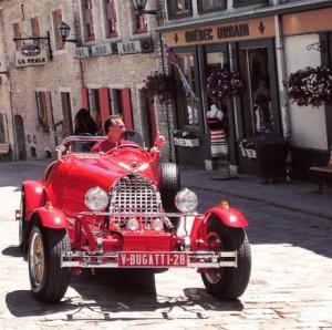 A vintage Bugatti drove by Le Petit Champlain!